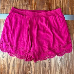TORRID pink embroidered shorts.
